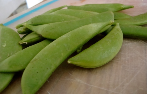 Fresh sugar snap peas add a sweet crunch to the dish.