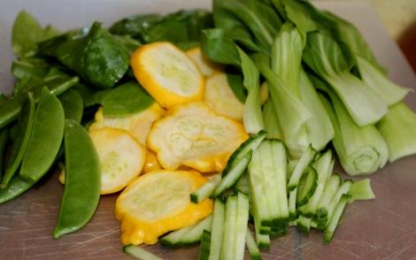 Spinach, snap peas, baby button squash, pak choi, cucumber.